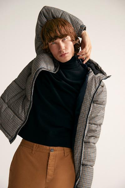 model posing wearing chinos and a coat