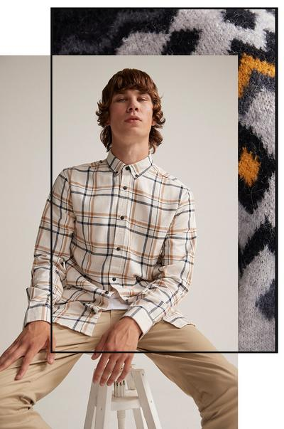 Model featuring cream checked shirt and chinos