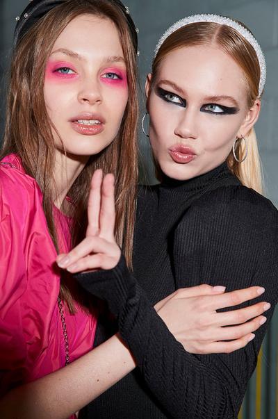 model with hot pink eyeshadow and headband