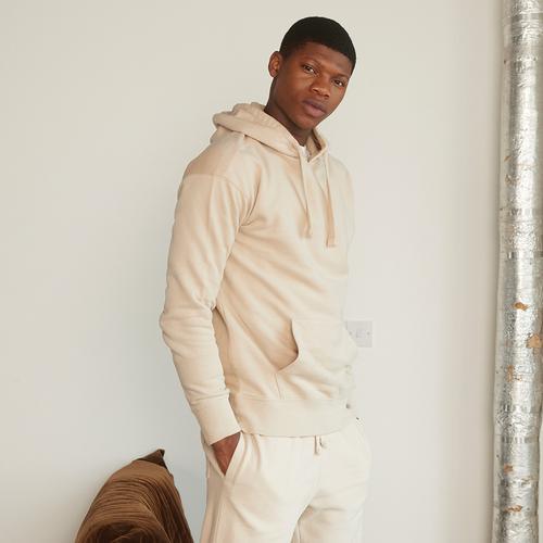 Model wearing light colored loungewear
