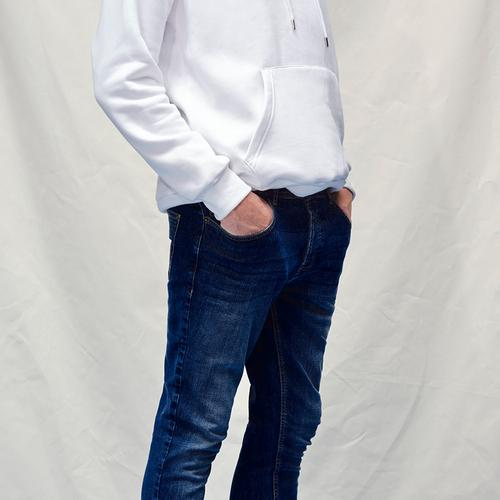 Close up of model wearing light color jeans