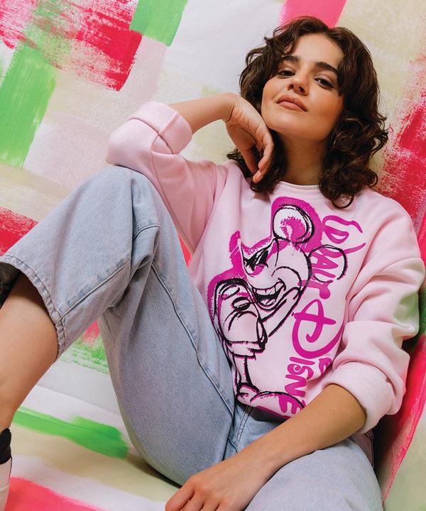 Model wearing Mickey Mouse sweatshirt
