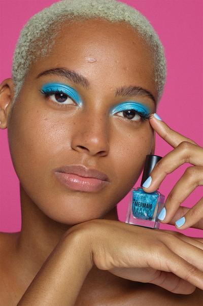 model with blue nail polish