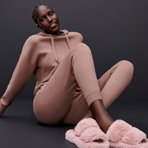 Model wearing hoodie and joggers