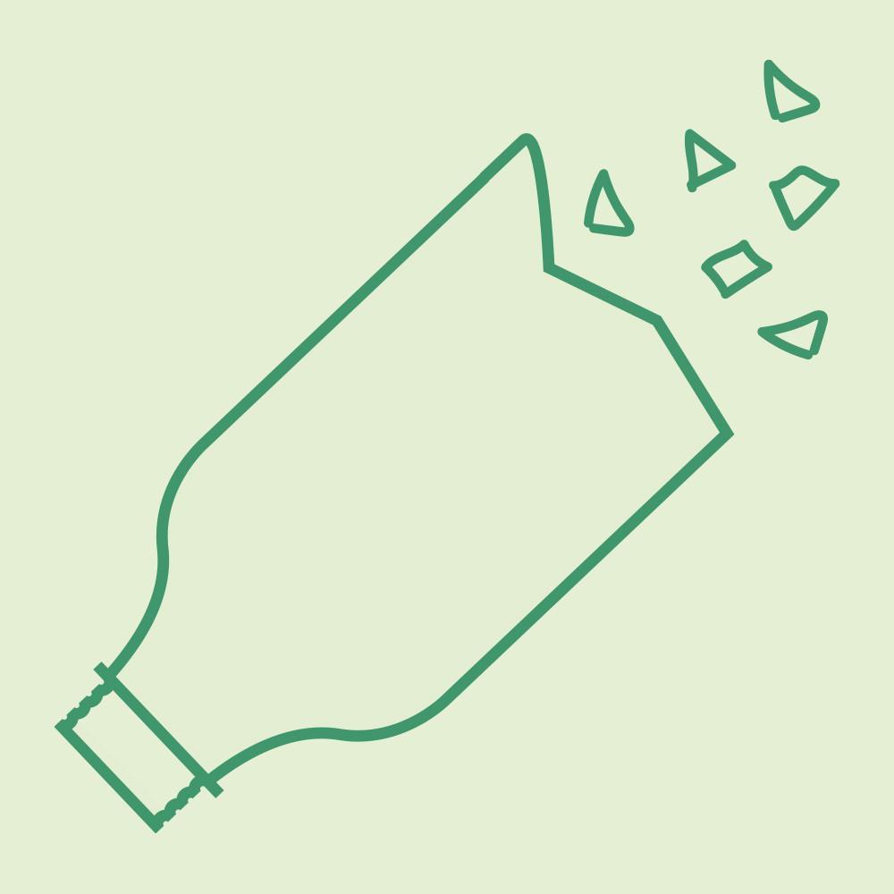 Plastic bottle being shredded on green background