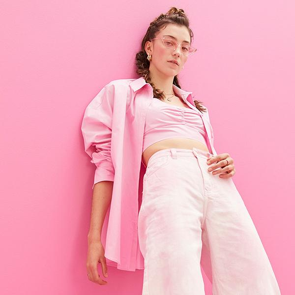 Model wearing pink outfit, jacket and glasses