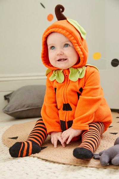 baby in a pumpkin outfit