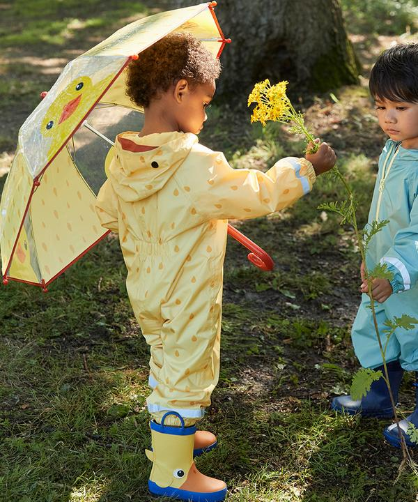 Two child models wearing puddlesuits