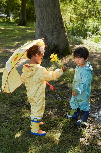 Two child models wearing puddlesuits, full size