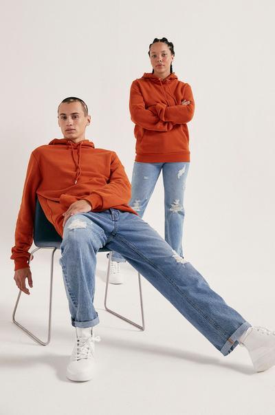 Models wearing Orange Hoodies and Blue Jeans