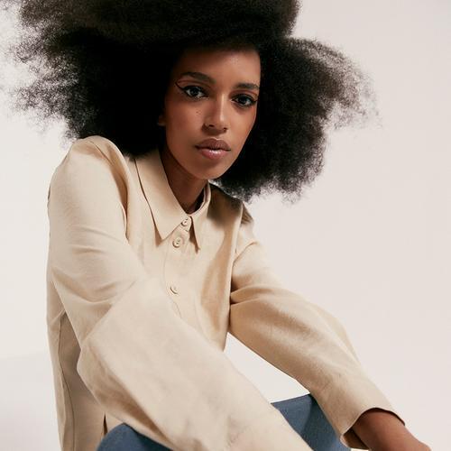 Model wearing light shirt dress