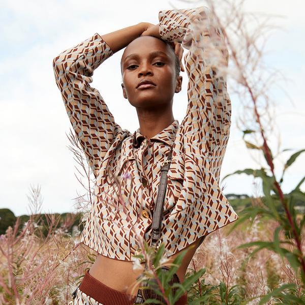 Model wearing patterned top