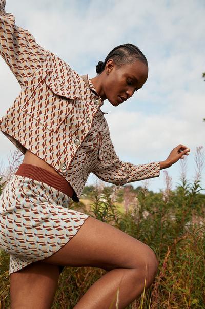 Model wears patterned two piece