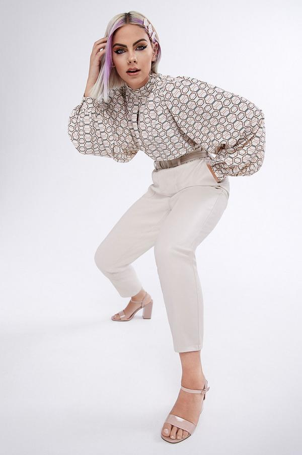 Sophie Hannah wearing beige pants and a printed shirt