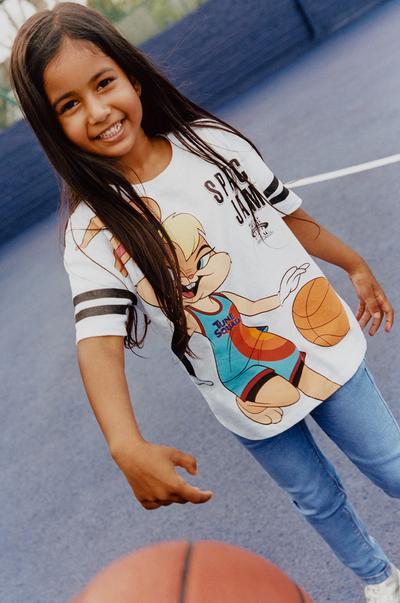 Model wearing White Space Jam Basketball T-shirt
