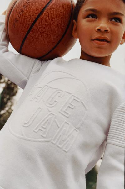 Model wearing White Space Jam Sweatshirt