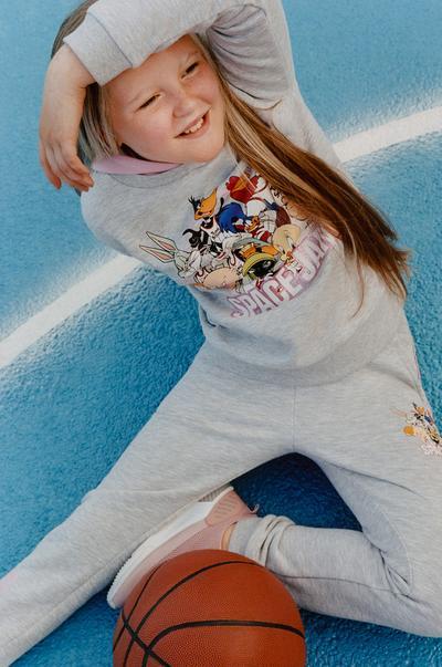 Model wearing Space Jam grey hoddie and joggers