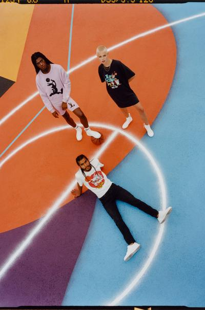 Models wearing Space Jam clothing on coloured background