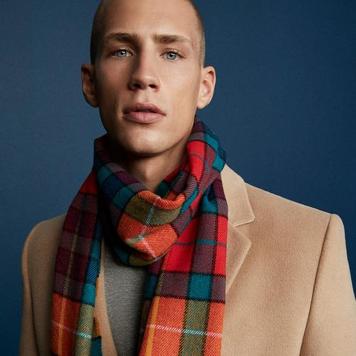 Primark model in coat and check scarf