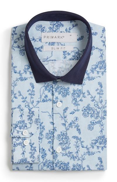 Camicia blu con motivo floreale
