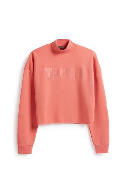 Koraalkleurig sweatshirt met slogan