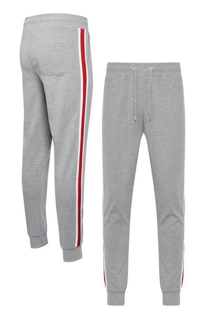 Pantalón chándal gris con raya lateral