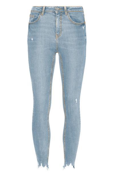Calças ganga desgastadas tornozelo azul-claro
