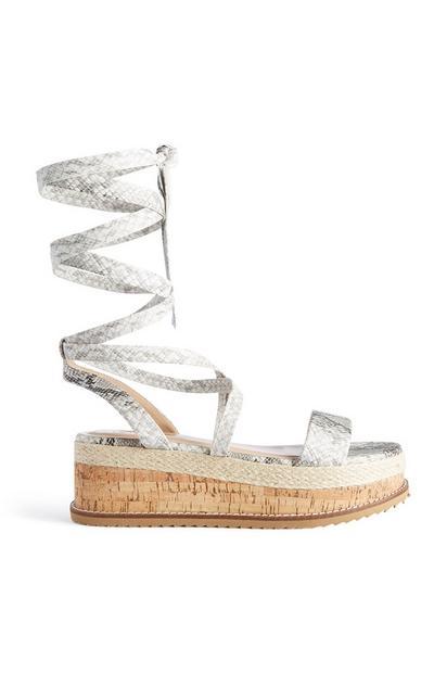 Sandaal met slangenprint en platformzool