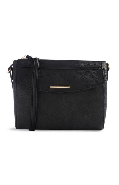 Črna torbica s kačjim vzorcem
