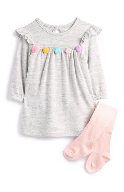 Grijze babyjurk en sokken met pompons