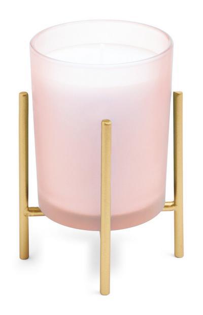 Vela cor-de-rosa com suporte dourado