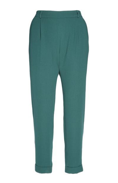 Donkergroene broek met smalle pijpen