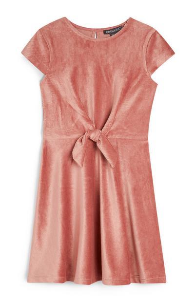 Rožnata obleka iz rebrastega žameta za mlajša dekleta s pentljo
