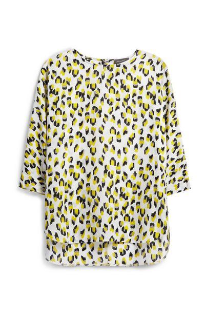 T-shirt bianca e gialla a fantasia