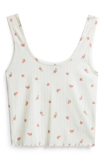 Camiseta blanca corta con estampado floral