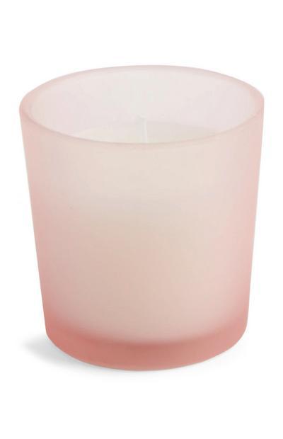 Rosafarbene Kerze im Glas