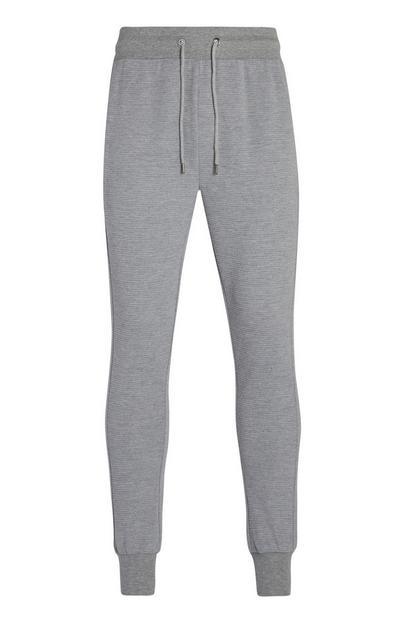 Jogging gris à chevilles côtelées