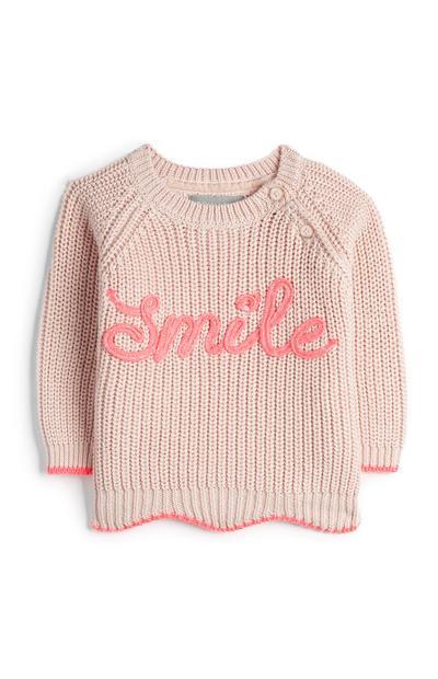 Maglione rosa con scritta Smile da bimba