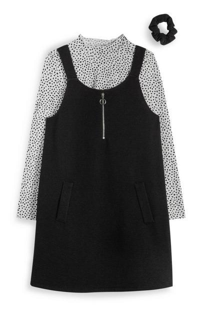 Črna obleka z naramnicami in zadrgo ter pikčasto sivo majico in elastiko za lase za dekleta