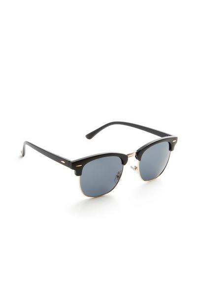 Sonnenbrille mit schwarz-goldener Fassung