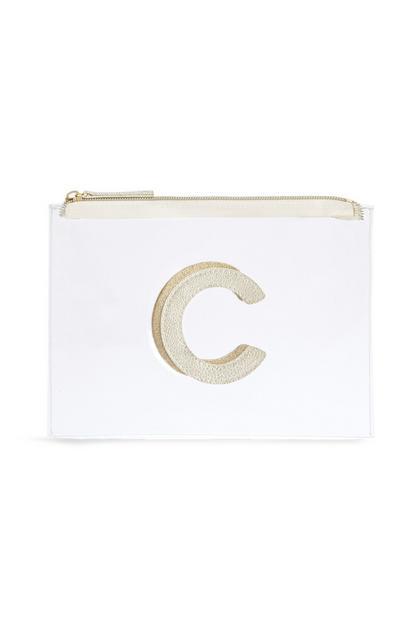 Neceser de maquillaje transparente con la letra «C»