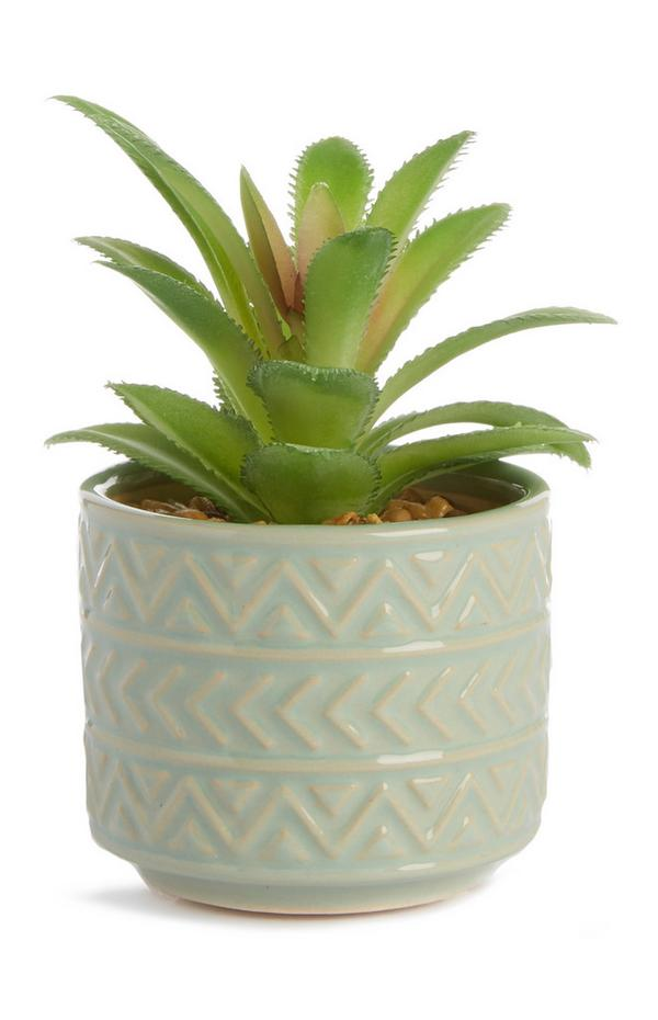 Pot en céramique pastel avec plante artificielle