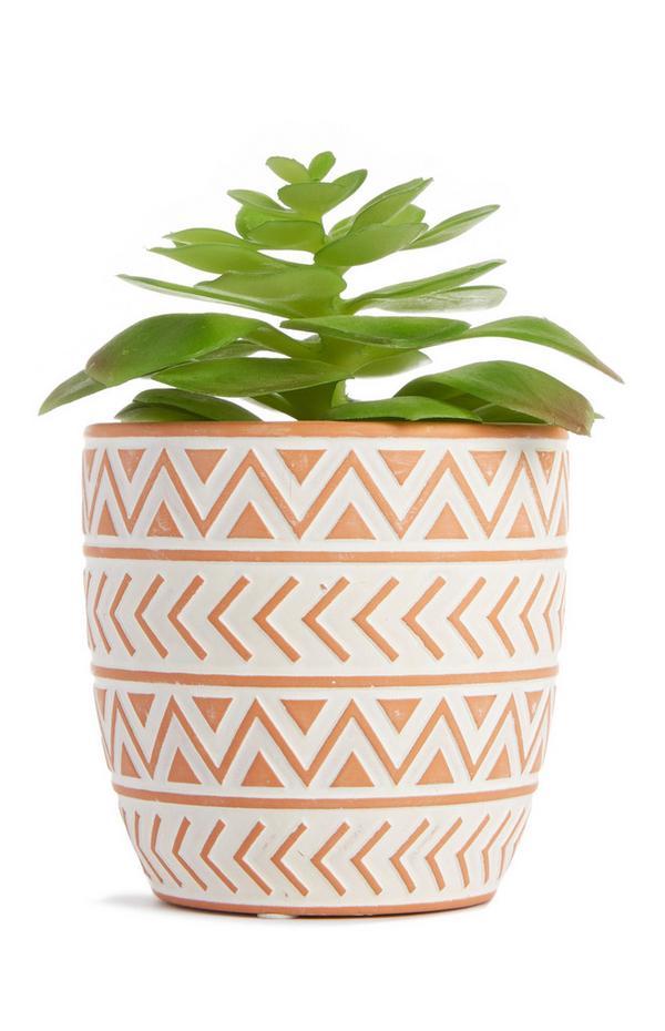Macetero pequeño de cerámica rosa con planta artificial