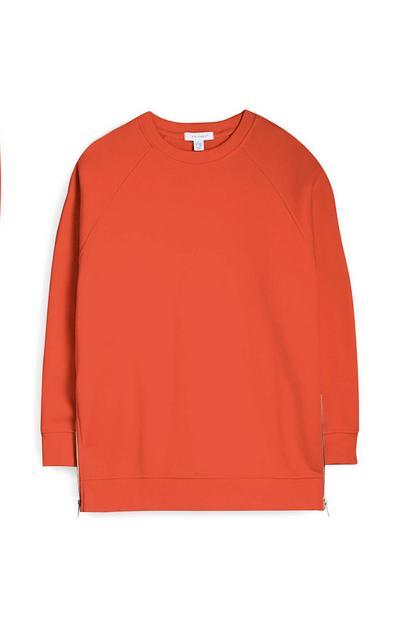 Maglia arancione oversize con cerniera laterale