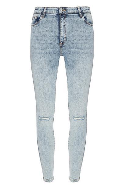 Helderblauwe gescheurde skinny jeans