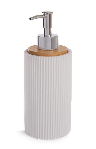 Witte dispenser met opstaande rand