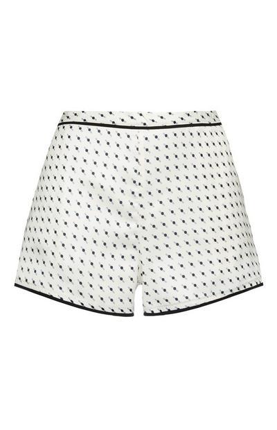 Shorts bianchi e neri in raso con stampa geometrica