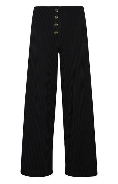 Losvallende zwarte geribde broek met knopen