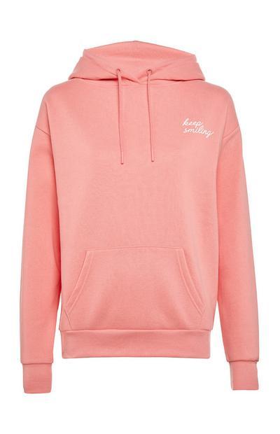 Sweat à capuche rose layette avec message et poche sur l'avant