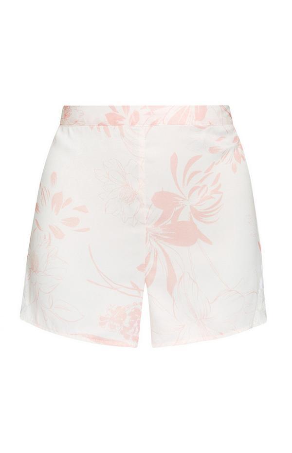 Pantalón corto de satén con estampado de hojas en color marfil